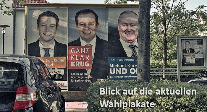 Plakate der drei Kandidaten für die OB-Wahlen am 14. Juni 2015